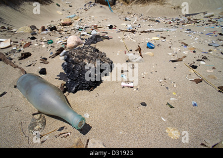 Plastic pollution and glass washed up on a beach, Camargue, France - Stock Photo