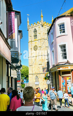 Looking down busy high street towards parish church, St Ives, Cornwall, England, UK - Stock Photo