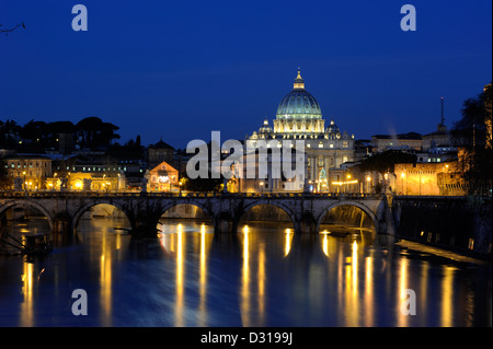 italy, rome skyline, tiber river, ponte sant'angelo and st peter's basilica at night - Stock Photo