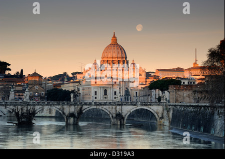 italy, rome, tiber river, ponte sant'angelo and st peter's basilica at dawn with the moon setting beside the dome - Stock Photo
