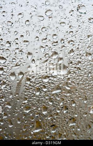 Rain on a window close up - Stock Photo