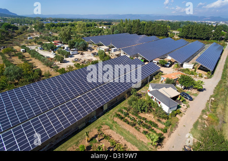 Solar panels on commercial greenhouses for food production, aerial view, Roquebrune-sur-Argens, Var region, France - Stock Photo