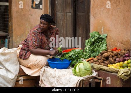 Woman selling vegetables in the market, Lamu town, Lamu Archipelago, Kenya - Stock Photo