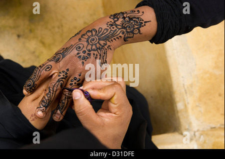 Swahili woman henna painting hands, Lamu, Lamu Archipelago, Kenya - Stock Photo