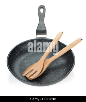 Frying pan with wooden utensils. Isolated on white background - Stock Photo