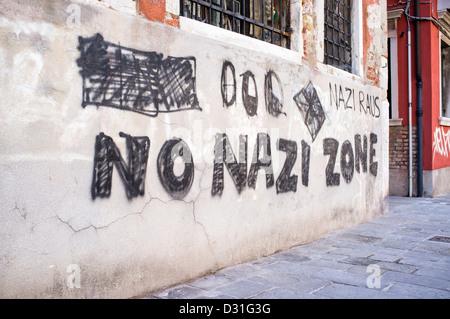 Anti Nazi Graffiti on a Wall in Dorsoduro District of Venice - Stock Photo
