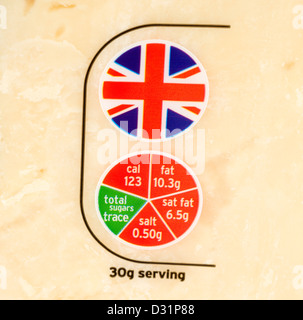 Close up of the British origin and 'traffic light' food labels on a pack of Sainsbury's cheddar cheese, UK - Stock Photo