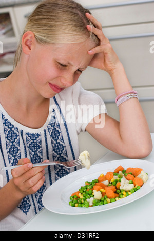 Girl does not want to eat - Stock Photo