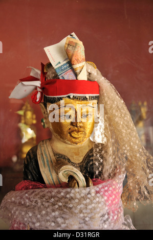 Figure of a Nat Spirit with money offering, Shwezigon Pagoda, Nyaung U, Bagan, Burma, Myanmar - Stock Photo