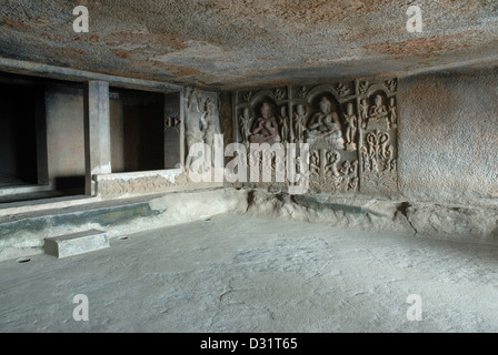 Front wall of the main hall, showing Mithuna couples on the left and right, with  stupa in the shrine. Cave 6, Kuda - Stock Photo