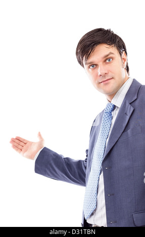Young business man with arm out in a welcoming gesture isolated on white - Stock Photo