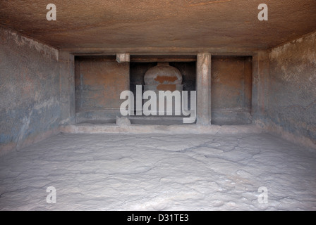 Stupa in the shrine and two octagonal pillars on the front, the left one is broken. Cave 1, Kuda Caves, Kolaba district - Stock Photo