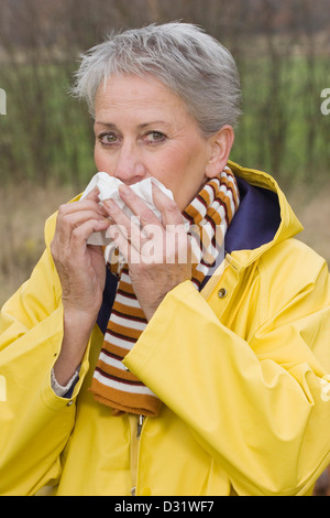 Elderly woman having a cold - Stock Photo