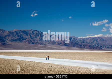 Death Valley National Park, California - Tourists on the salt flat in Badwater Basin. - Stock Photo