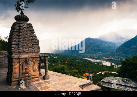 Kali Mandir temple with Kullu Valley overview and misty mountains backdrop. Naggar, Himachal Pradesh, India - Stock Photo