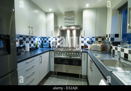 Small Modern Kitchen; A Small, Modern Domestic Kitchen With A Range Cooker  And Lots Of Storage Space.