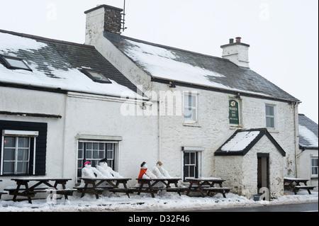 Snowy winter weather on Dartmoor by the Warren House Inn. - Stock Photo