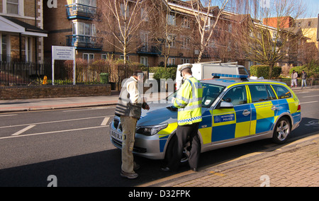 Police stop motorist in Croydon Greater London United Kingdom - Stock Photo