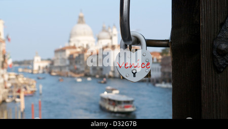 heart shaped love locks lovers padlock attached to the Ponte dell'Accademia bridge over the Grand Canal Venice Italy - Stock Photo