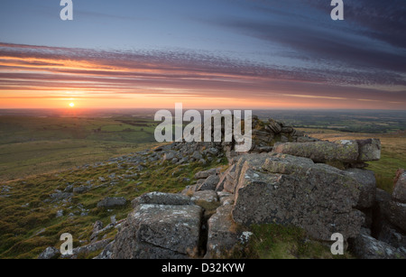 Sunset from Belstone Tor with views over th Devon countryside. Dartmoor National Park Devon Uk - Stock Photo
