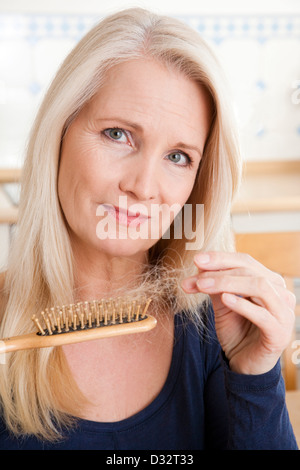Woman suffering from loss of hair - Stock Photo
