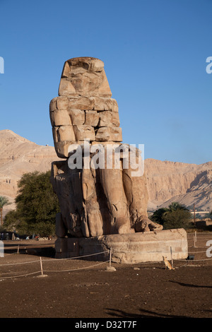 The Colossi of Memnon, two statues of Amenhotep 3rd near Thebes on the West Bank of the River Nile in Egypt - Stock Photo