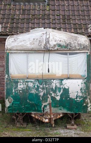 old caravan, abandoned, derelict, decrepit, peeling paintwork. disused, - Stock Photo