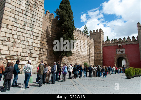 Long line of tourists queuing to enter the Alcazar of Seville, Andalucia, Spain - Stock Photo