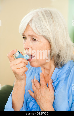 Elderly lady suffering from asthma - Stock Photo