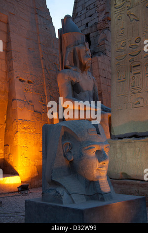 Colossal head of Ramses 2nd at the entrance to the first pylon built by him at the  Luxor Temple in Egypt - Stock Photo