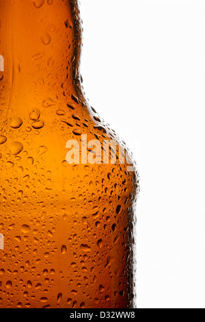 Water droplets on chilled transparent brown beer bottle - Stock Photo