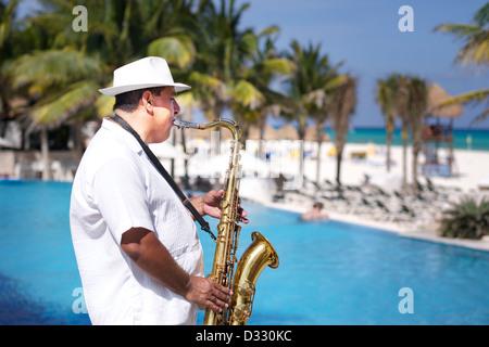 Man playing Saxophone at beach