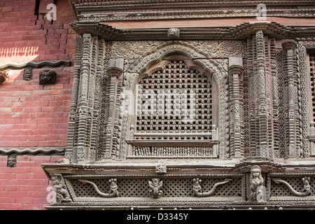 Ancient, ornately carved wood window frames on an old building in ...