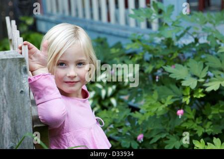beautiful child opening gate - Stock Photo