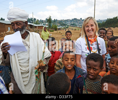 Margaret D. Lowman or 'Canopy Meg' poses with a group of children and a priest in Bahir Dar - Stock Photo