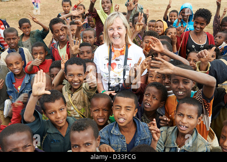 Margaret D. Lowman or 'Canopy Meg' poses with a group of children in Bahir Dar - Stock Photo