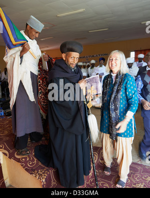 Margaret 'Canopy Meg' Lowman with a Christian Priest at a conference on the conservation of church forests in Ethiopia. - Stock Photo