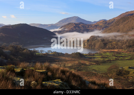 Scenic view along a valley to Llyn Gwynant lake with mist in mountains of Snowdonia National Park, Nantgwynant, North Wales, UK