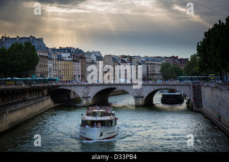 Sightseeing boat on the river Seine in Paris, France - Stock Photo