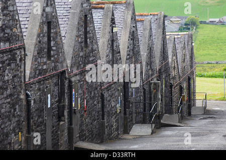 Warehouses of a Scottish whisky distillery. - Stock Photo