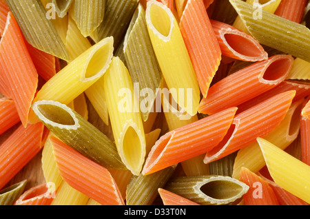 Raw tricolor pasta penne background - Stock Photo