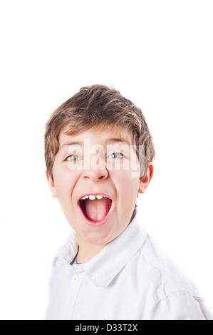 European boy in the white shirt, screaming - Stock Photo
