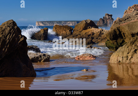 Portugal, Algarve: Waves and ebb tide at surfer´s beach Praia do Tonel in Sagres - Stock Photo
