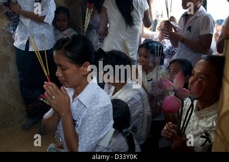Cambodians, very focused, mourn the loss of King Norodom Sihanouk, on the riverside, Phnom Penh, Cambodia on Feb. - Stock Photo