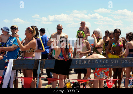 Revellers enjoy the sights and the sunshine at the annual Coney Island Mermaid Parade, 2012. - Stock Photo