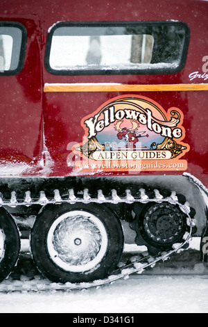 Detail of a red Bombadier snowbus in Yellowstone National Park, United States - Stock Photo