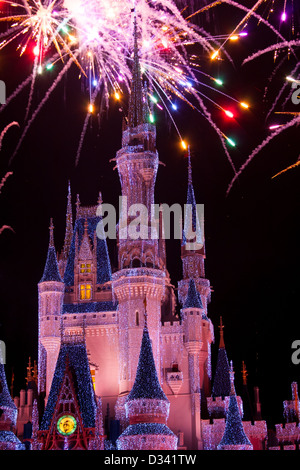 Disney World Castle At Night With Lights And Fireworks - Stock Photo