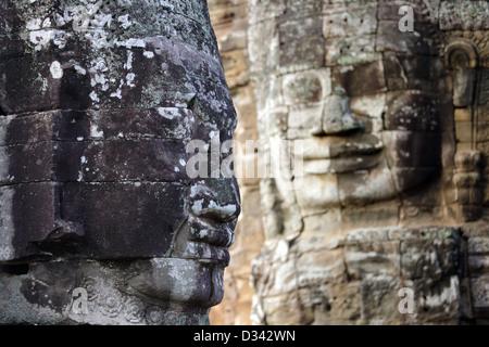 Giant religious stone faces in Bayon temple, Angkor, Cambodia