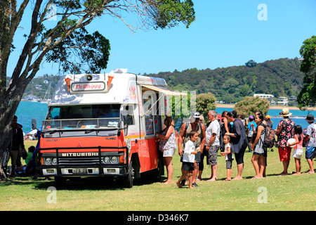 Line of people queue up for a Mr Whippy ice cream during Waitangi Day celebrations at the Waitangi Treaty grounds - Stock Photo