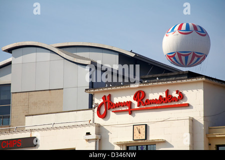 Bournemouth balloon over the IMax building on the waterfront and Harry Ramsden's Fish & Chip restaurant in March - Stock Photo